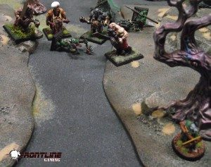 Craxis sneaks up on the Ogres to see what the brutes are doing.