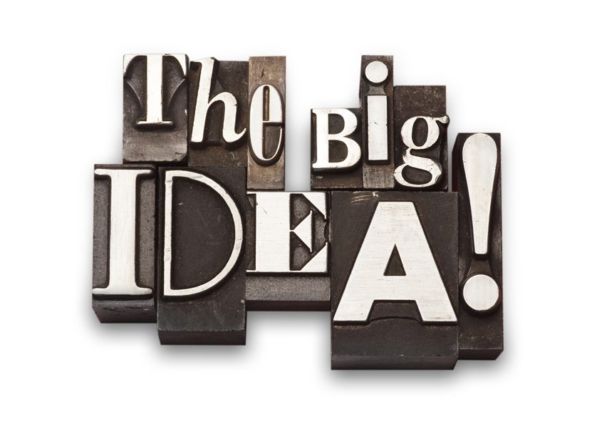 "The phrase ""The Big Idea!"" done in old letterpress type on a red fabric background."